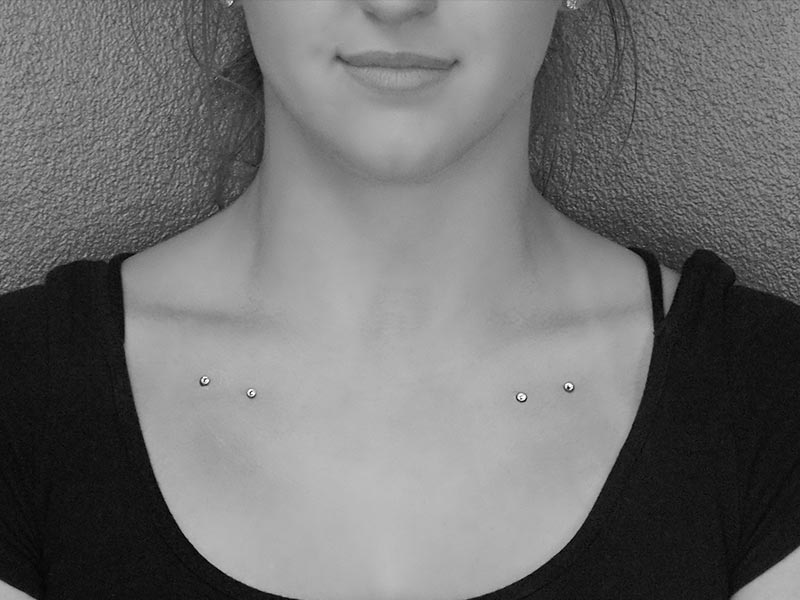 Dermal implants on the collar bones at Steel and Ink studio St Louis MO